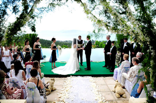 Bride and groom married with villa seaviews