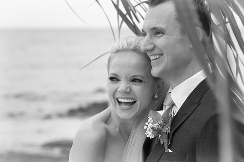 Couple smiling at wedding photo on a Samui beach