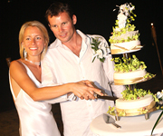 The perfect couple cutting their Wedding Cake on their big day.