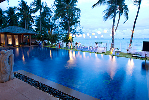 Guests around a private pool enjoying a Koh Samui weddings