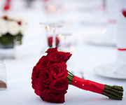 The most common flowers that we use in weddings are white orchid, water lily and Red Rose which is pictured.